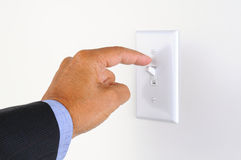 Man Turning off the Lights Royalty Free Stock Photo