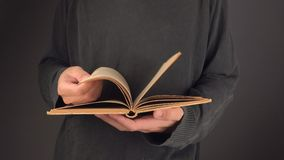 Man turning yellow pages of old vintage book stock footage