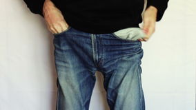 Man turns the empty pockets of his jeans. No money stock video