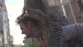 Man turns a girl on his back stock footage
