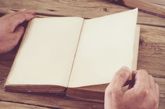 Man turns the page book close up Royalty Free Stock Photo