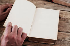 Man turns the page old book close up Stock Image