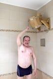 Man turns tub Royalty Free Stock Image