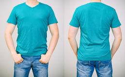Man in turquoise t-shirt. Royalty Free Stock Images