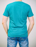 Man in turquoise t-shirt. Stock Photography