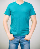 Man in turquoise t-shirt. Royalty Free Stock Image