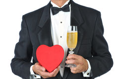 Man in tux with champagne and heart Royalty Free Stock Photos