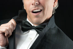 Man In Tux Does Elvis Impression Royalty Free Stock Photos