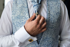 Man in a tux fixing his cufflink Royalty Free Stock Photos