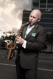 Man in a tux playing a saxophone Stock Photography