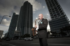 Man in a tux playing a saxophone Royalty Free Stock Images