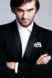 Man in tuxedo. Elegant young man in black tuxedo, portrait, studio shot, close up Stock Photography