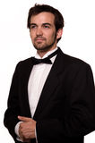 Man in tuxedo. Attractive young brunette man with a beard wearing a black tuxedo Stock Photo