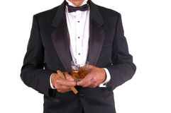 Man in Tuxedo with Drink and Cigar. Isolated over white Stock Photo