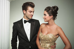 Man in tuxedo embracing his woman and smiles Stock Image