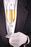 Man in Tuxedo with Glass of Champagne. Man in Tuxedo with Champagne Glass close-up shot- vertical royalty free stock images