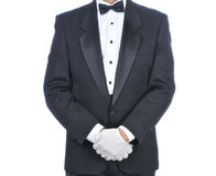 Man in Tuxedo with Hands in Front of Body Stock Photography