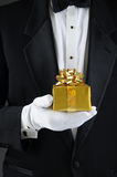 Man in Tuxedo Holding Christmas Gift Stock Photography