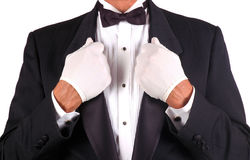 Man in Tuxedo Holding Lapels. In Both Hands isolated over white Stock Photos
