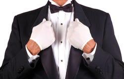 Man in Tuxedo Holding Lapels Stock Photos
