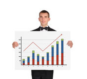 Man in tuxedo holding placard with chart Stock Photo