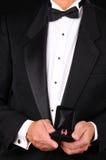 Man in Tuxedo Holding Ring Box Royalty Free Stock Photography