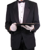 Man in Tuxedo Holding Serving Tray. Isolated over white Royalty Free Stock Photo