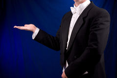 Man in Tuxedo with open hand Stock Images