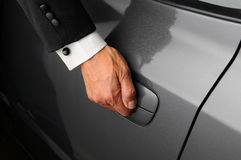 Man in Tuxedo Opening Car Door Royalty Free Stock Photos