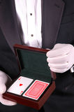 Man in Tuxedo with Playing Cards Stock Photos