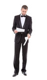 Man in a tuxedo reading the document Stock Photos