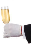Man in Tuxedo Serving Champagne. Glass isolated over white stock photos