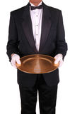 Man in Tuxedo with Tray. Man in Tuxedo with Gold Serving Tray isolated over white Royalty Free Stock Images