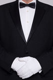 Man in a tuxedo wearing white gloves. Stock Photo
