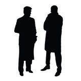 Man två i svart kontur för dräkter på vit Arkivfoton