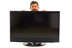 Man and TV Royalty Free Stock Images
