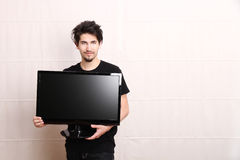 Man with a tv Royalty Free Stock Image