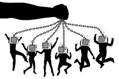 Man of TV. The hand holds a zombie crowd of people with television. The puppeteer keeps the puppets on chains Royalty Free Stock Images