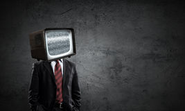 Man with TV instead of head . Mixed media royalty free stock photo
