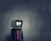 Man with TV instead of head . Mixed media royalty free stock photos