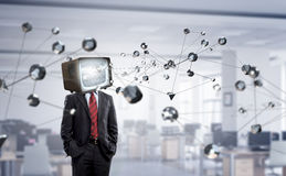 Man with TV instead of head . Mixed media stock photo