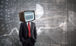 Man with TV instead of head . Mixed media . Mixed media stock image