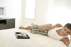 Man With TV in Hotel Room Royalty Free Stock Photo