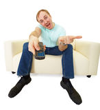 Man with TV remote control royalty free stock images