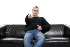 Man with tv remote control Stock Photos