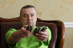 Man with a TV remote control. Man with three TV's remote control Royalty Free Stock Image
