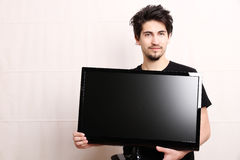 Man with a TV Stock Images