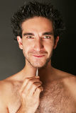 Man with tweezers Royalty Free Stock Images