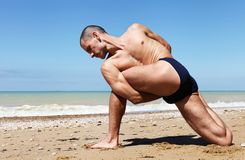 Man in twisted side angle yoga pose Stock Photos