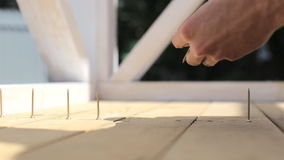 The man twists the screws into the boards using a screwdriver. stock video